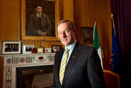 Culture: Taoiseach Enda Kenny in front of a portrait of Michael Collins in his office Photo: Tony Gavin