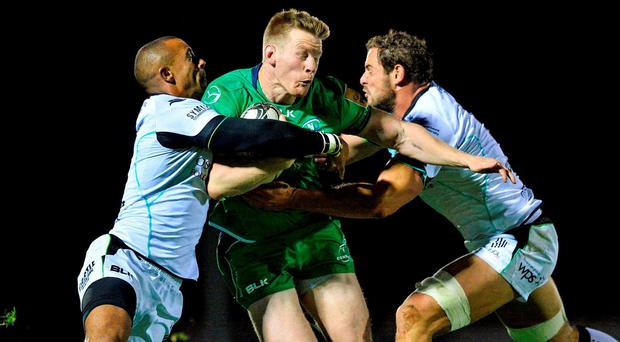 Eoin Griffin of Connacht is tackled by Eli Walker and Tyler Ardron of Ospreys during the Guinness PRO12 Round 2 match between Connacht and Ospreys at the Sportsground in Galway. Photo by Ray Ryan/Sportsfile
