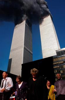 Before the fall: Smoke billows from the Twin Towers Photo: Spencer Platt/Getty Images