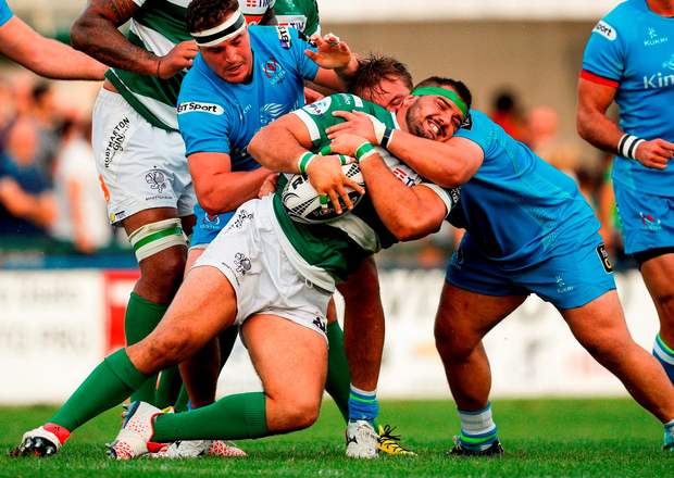 Benetton Trevis' Simone Ferrari is tackled by Ulster's Kyle McCall and Rob Herring. Photo: Roberto Bregani/Sportsfile