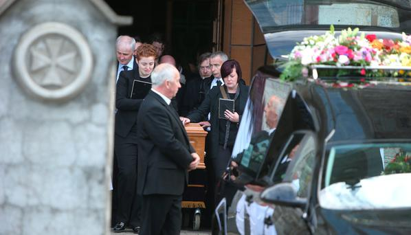 Donna Fox's partner Anne Marie Ryan (left) and her sister, Leanne, after her funeral mass at St Peter and Paul's Church in Balbriggan Photo: Damien Eagers