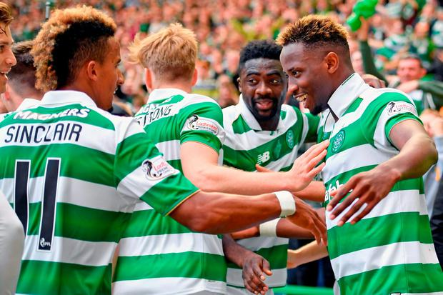 Moussa Dembelle of Celtic celebrates after scoring his third goal. Photo by Jeff J Mitchell/Getty Images