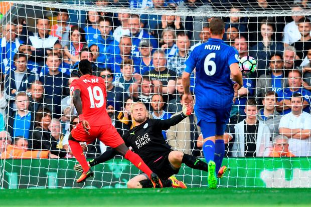 Sadio Mane of Liverpool scores his sides second goal past Kasper Schmeichel. Photo by Michael Regan/Getty Images