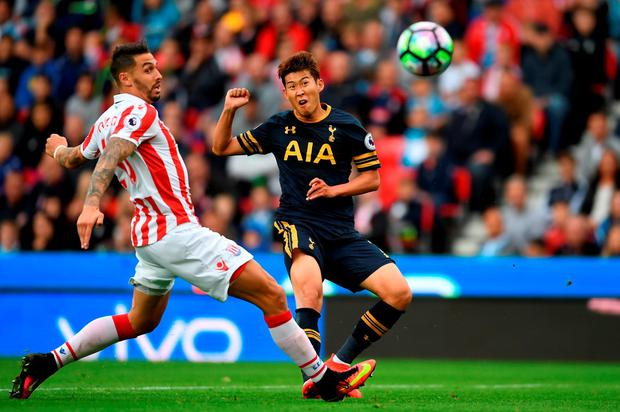 Heung-Min Son of Tottenham Hotspur scores his sides second goal. Photo by Laurence Griffiths/Getty Images