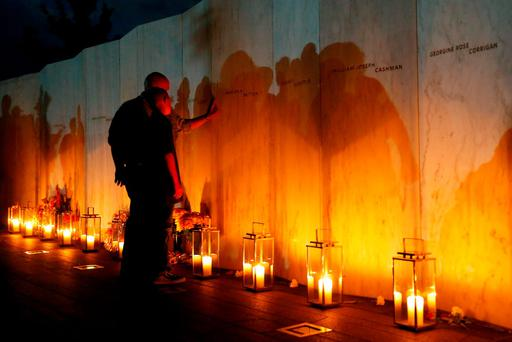 Visitors pay tribute to the passengers and crew of Flight 93 on the Wall of Names at the Flight 93 National Memorial in Shanksville (AP Photo/Jared Wickerham)