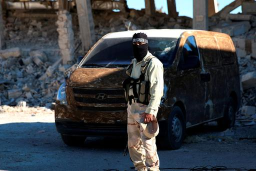 A rebel fighter stands near a vehicle in Quneitra countryside, Syria September 10, 2016. REUTERS/Alaa Al-Faqir
