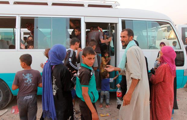 Displaced Iraqis, who had fled to Syria to escape the violence in Mosul, transfer to a refugee camp in Kirkuk as they return to Iraq September 10, 2016. REUTERS/Ako Rasheed
