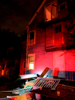 This photo provided by the Hartford Police Department shows a collapsed deck at a house near Trinity College in Hartford, Conn. (Hartford Police Department via AP)