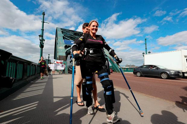 Paralysed former horse rider Claire Lomas on the Tyne Bridge as she takes part in the Great North Run in Newcastle starting five days early wearing her Òbionic suitÓ. PRESS ASSOCIATION Photo. Picture date: Wednesday Septemer 7, 2016. Photo credit: Owen Humphreys/PA Wire