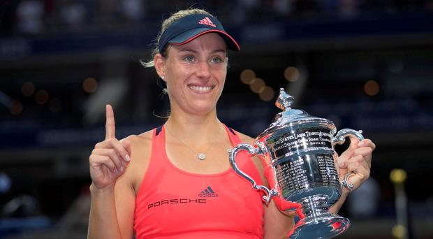 Angelique Kerber (GER) poses with the trophy after her triumph last night