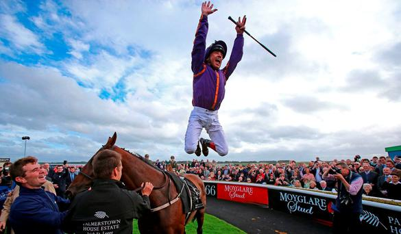 Wicklow Brave's jockey Frankie Dettori celebrates winning The Palmerstown House Estate Irish St. Leger during day two of the Longines Irish Champions Weekend at Leopardstown Races. Niall Carson/PA Wire.