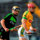 Sean Quigley of Meath tries to solo away from Mayo's David Kenny during Saturday's Bord Gais Energy All-Ireland U-21 hurling 'B' final. Photo by Ray McManus/Sportsfile