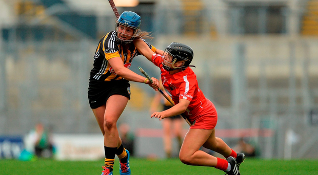 Julie Ann Malone of Kilkenny brushes off Cork's Pamela Hickey during yesterday's Liberty Insurance All-Ireland Senior Camogie final at Croke Park. Photo by Eóin Noonan/Sportsfile
