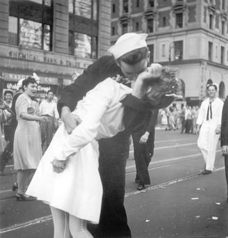 George Mendonsa plants a kiss on a surprised Greta Friedman in Times Square in this version of the scene captured by photographer Victor Jorgensen. (AP Photo/U.S. Navy/Victor Jorgensen, File)