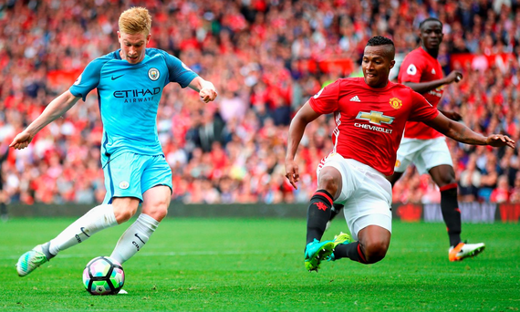 Kevin De Bruyne gets in his shot despite the efforts of Antonio Valencia Photo: Clive Brunskill/Getty Images
