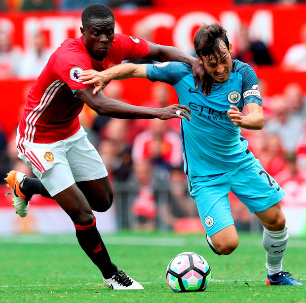 David Silva tries to get away from Eric Bailly Photo: Martin Rickett/PA Wire