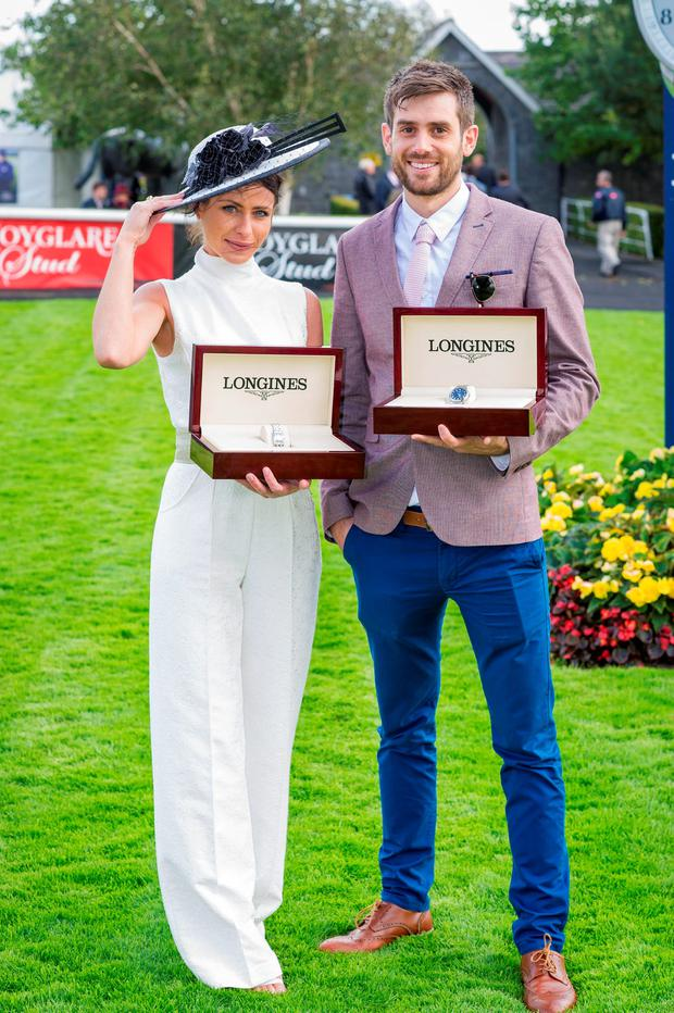 Anna McGuire, who won the Most Elegant Woman prize, and Chris Bonini, winner of the Most Elegant Man award, at the Longines Irish Champions Weekend at the Curragh racecourse