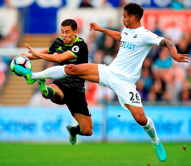 Chelsea's Eden Hazard (left) and Swansea City's Kyle Naughton (right) battle for control of the ball Photo: Mike Egerton/PA Wire