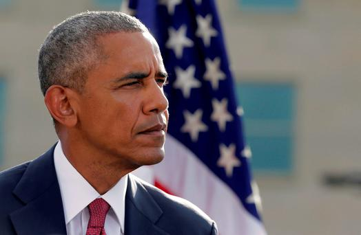U.S. President Barack Obama waits to speak during a ceremony marking the 15th anniversary of the 9/11 attacks at the Pentagon in Washington. Photo: REUTERS/Joshua Roberts