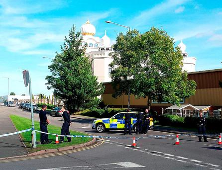 Police outside the Sikh temple in Leamington Spa, UK. Photo credit: @gmbperry/PA Wire