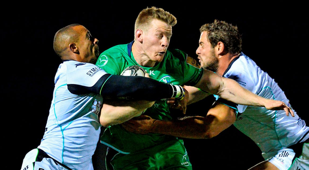 Eoin Griffin is tackled by Eli Walker and Tyler Ardron Photo: Ray Ryan/Sportsfile