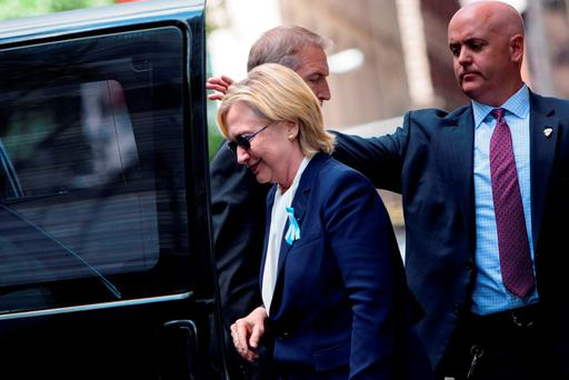 US Democratic presidential nominee Hillary Clinton gets in her car while leaving her daughter's apartment building after resting on September 11, 2016