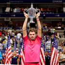 Stan Wawrinka, of Switzerland, holds up the championship trophy after beating Novak Djokovic, of Serbia, to win the men's singles final of the U.S. Open tennis tournament, Sunday, Sept. 11, 2016, in New York. (AP Photo/Darron Cummings)