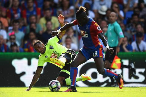 LONDON, ENGLAND - AUGUST 27: Callum Wilson of AFC Bournemouth (L) battles with Pape Souare of Crystal Palace (R) during the Premier League match between Crystal Palace and AFC Bournemouth at Selhurst Park on August 27, 2016 in London, England. (Photo by Patrik Lundin/Getty Images)