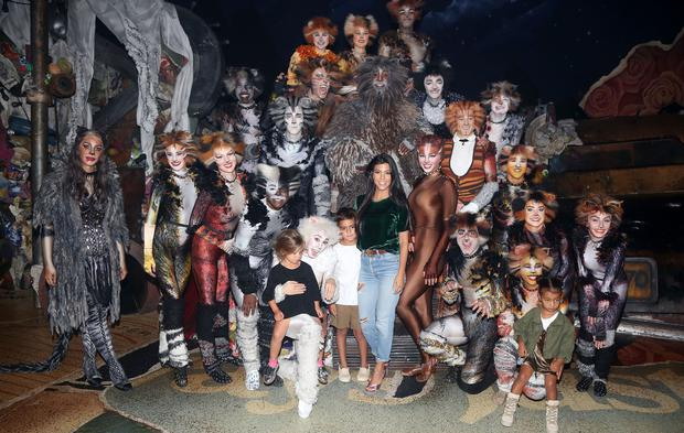 Kourtney Kardashian, Mason Disick, North West and Penelope Disick pose backstage with the cast at