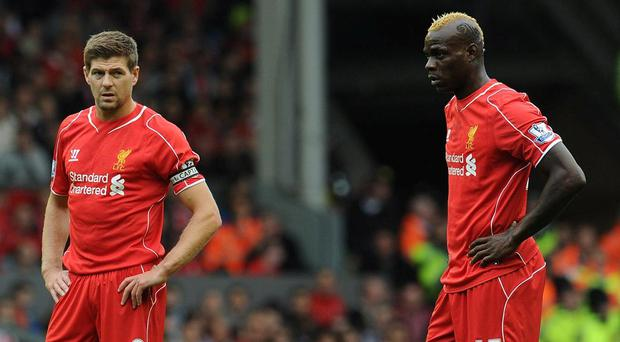 Steven Gerrard and Mario Balotelli pictured at Liverpool. GETTY IMAGES