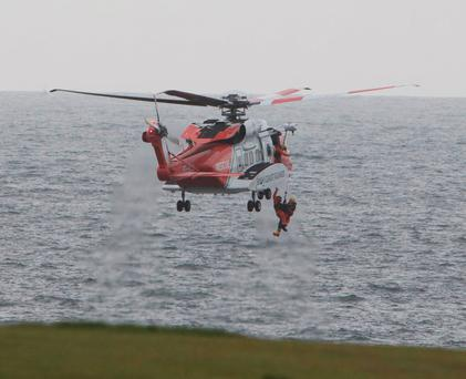 A man (left) is air lifted from the sea after he became trapped in a cave below the cliffs in Kilkee, Co Clare Photo Press 22