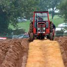 A farmer ploughs a straight furrow at the South Kerry Ploughing Championships at Fossa, Killarney on Sunday. Photo: Don MacMonagle