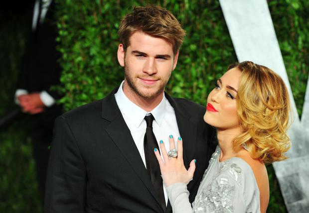 WEST HOLLYWOOD, CA - FEBRUARY 26: Actor Liam Hemsworth (L) and entertainer Miley Cyrus arrive at the 2012 Vanity Fair Oscar Party hosted by Graydon Carter at Sunset Tower on February 26, 2012 in West Hollywood, California. (Photo by Alberto E. Rodriguez/Getty Images)