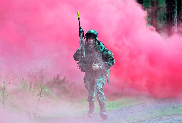 A member of the Defence Forces during a simulated ambush at the Glen of Imaal. Picture Colin Keegan, Collins Dublin.