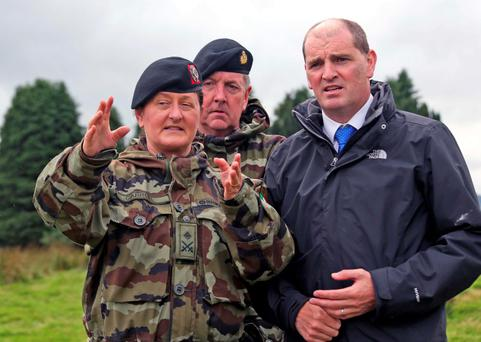 Minister of State with responsibility for Defence, Paul Kehoe with Lt. Col. Mary Carroll who is leading the mission, and Vice Admiral Mark Mellett, Chief of Staff pictured at the Glen of Immal. Picture Colin Keegan, Collins Dublin.