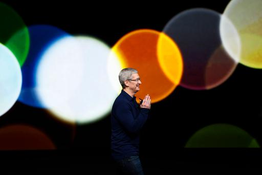 Apple CEO Tim Cook waves as he arrives on stage during the iPhone 7 launch event in San Francisco, California. (Photo by Stephen Lam/Getty Images)