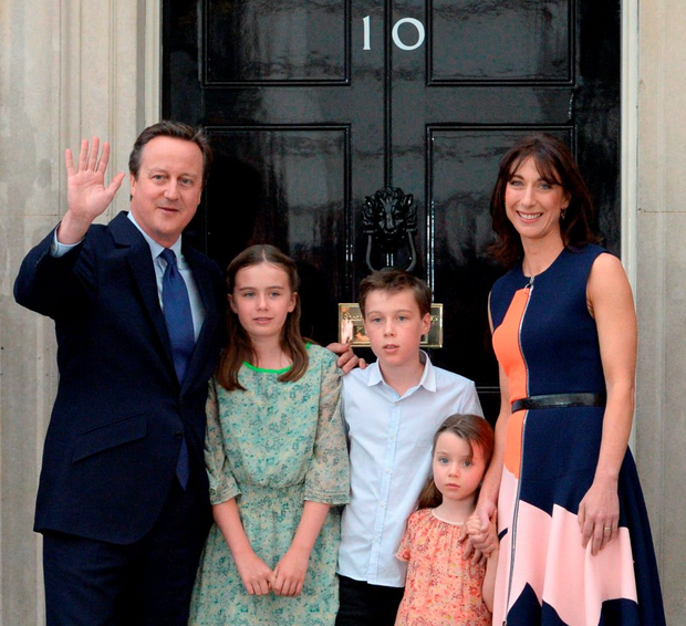 Cameron outside Downing Street with his children Nancy Gwen, Arthur Elwen, Florence Rose Endellion and his wife Samantha Photo: OLI SCARFF/AFP/Getty Images