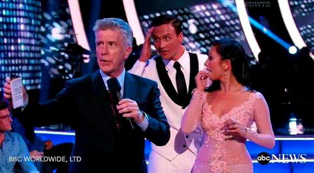 Host Tom Bergeron, left, and Ryan Lochte with his partner Cheryl Burke Credit: ABC