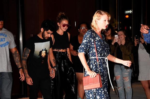 Taylor Swift,GiGi Hadid and Zayn Malik are seen walking in Soho on September 12, 2016 in New York City. (Photo by Raymond Hall/GC Images)