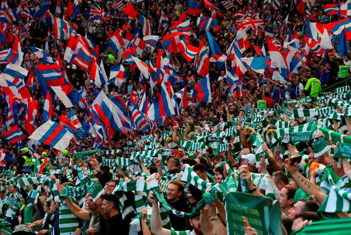 Celtic and Rangers fans show their support ahead of the Old Firm