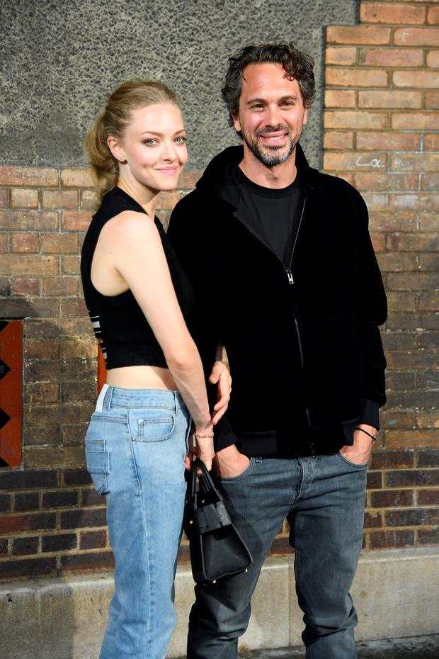 Amanda Seyfried and Thomas Sadoski attend the Givenchy Menswear Spring/Summer 2017 show as part of Paris Fashion Week on June 24, 2016 in Paris, France. (Photo by Pascal Le Segretain/Getty Images)