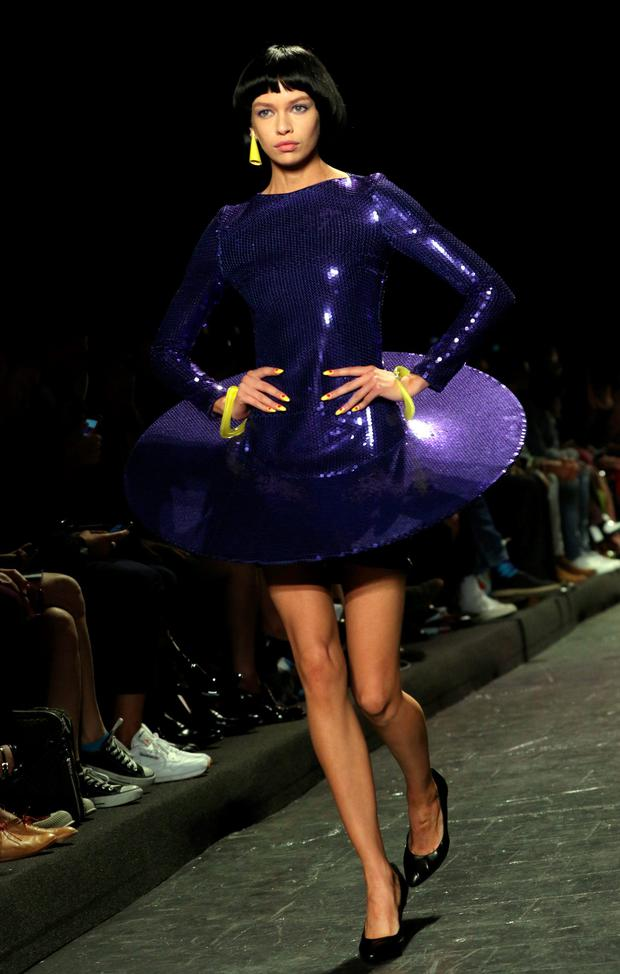 Stella Maxwell walks the runway during the Jeremy Scott show at New York Fashion Week in New York, on September 12, 2016. / AFP PHOTO / TREVOR COLLENSTREVOR COLLENS/AFP/Getty Images