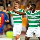 Barcelona's Andres Iniesta, left, celebrates past Celtic's Kolo Toure, right, and Mikael Lustig after scoring his side's fourth goal during a Champions League, Group C soccer match between Barcelona and Celtic, at the Camp Nou