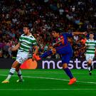 Luis Suarez hammers home Barcelona's sixth goal against Celtic last night. Photo: David Ramos/Getty Images