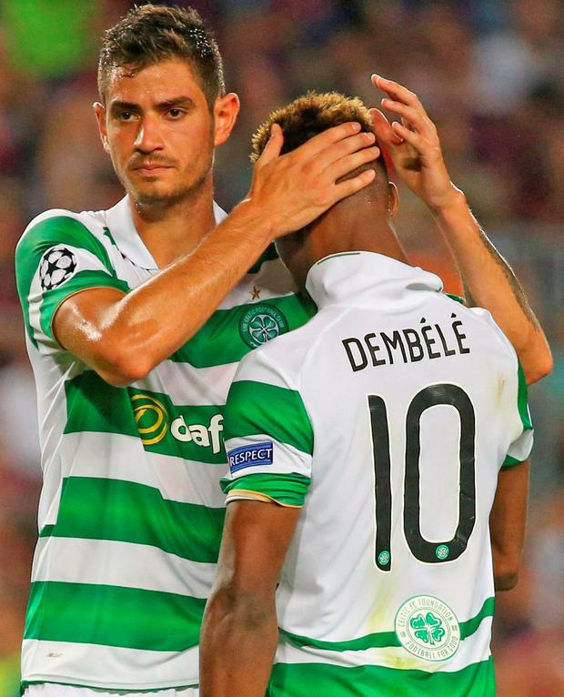Celtic's Nir Bitton consoles Moussa Dembele after his missed penalty. Photo: Paul Hanna/Reuters