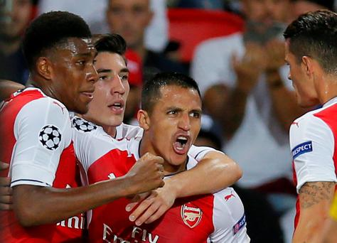 Alexis Sanchez (c) celebrates after scoring Arsenal's equaliser. Photo: Gonzalo Fuentes/Reuters