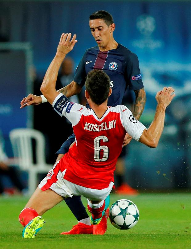 Paris Saint-Germain's Angel Di Maria in action with Arsenal's Laurent Koscielny. Photo: Benoit Tessier/Reuters