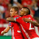 Bayern Munich's Joshua Kimmich celebrates with his team mate Arturo Vidal after scoring. Photo: Michaela Rehle/Reuters