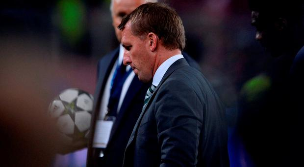 Celtic's coach Brendan Rodgers leaves the pitch after the UEFA Champions League football match FC Barcelona vs Celtic FC at the Camp Nou stadium