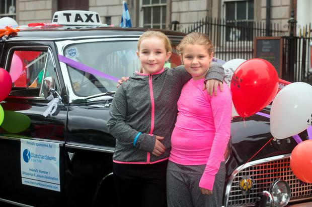 Chloe Ward, 10 and Caoimhe O'Connell, 10 from St Mary's Boarding Campus for Deaf on Parnell Square during the Special Children's Taxi Day out. Photo: Tony Gavin 13//9/2016